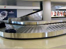Photo of airport baggage claim area